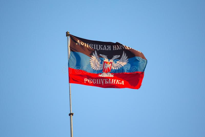 Donetsk, Ukraine - April 14, 2018: National flag of the Donetsk People`s Republic. On a flagpole stock photo