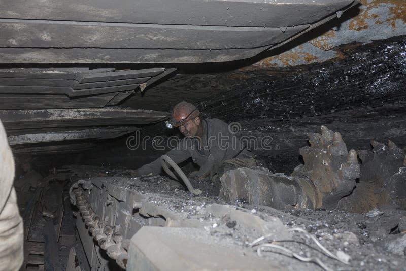 Donetsk, Ukraine - August, 16, 2013: Miner near the coal mining. Shearer. Mine is named Chelyuskintsev stock photography