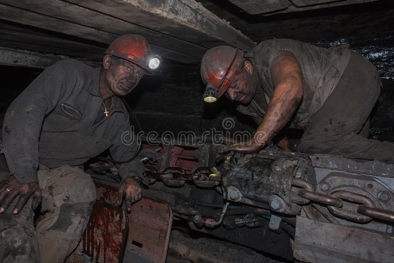 Donetsk, Ukraine - August, 16, 2013: Miners near the coal mining. Shearer. Mine is named Chelyuskintsev royalty free stock photo
