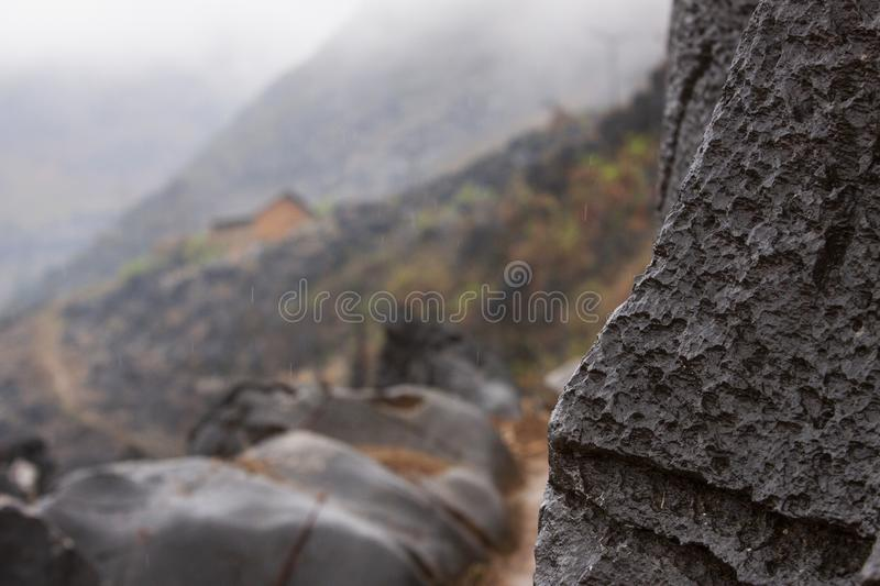 Black stone in Dong Van GeoPark stone plateau in dust and rain. Dong Van Karst Plateau Global GeoPark is in the North and the Northeast, comprising 4 districts royalty free stock images