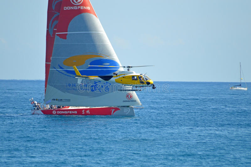 Dongfeng Race Team And A Helicopter Film Crew royalty free stock photography