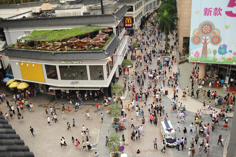 Dongmen Pedestrian Street in ShenZhen. SHENZHEN, CHINA-MAY 27: Shoppers and visitors crowd the famous Dongmen Pedestrian Street on May 27, 2012 in Shenzhen royalty free stock photography