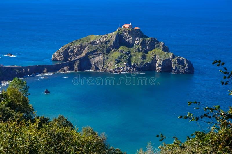 Doniene Gaztelugatxeko hermitage on top of Gaztelugatxe island. Biscay, Basque Country, Spain.  stock images