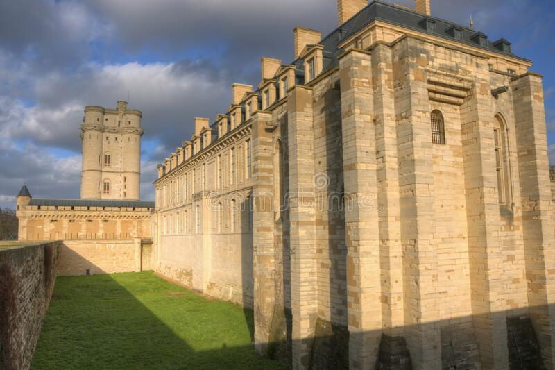 Donjon with west side of the Chateau de Vincennes in a low winter sun. Seen from the street stock photos