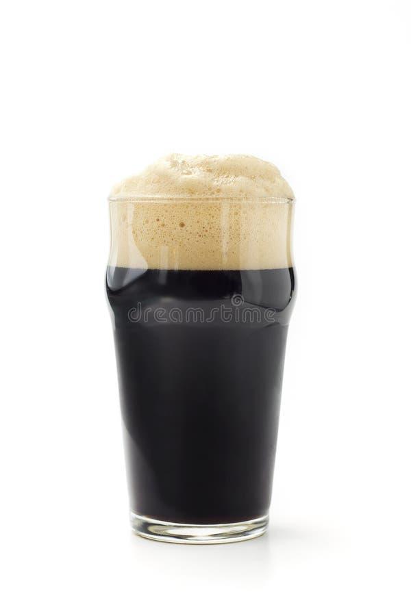 Donker bier met schuim royalty-vrije stock afbeelding