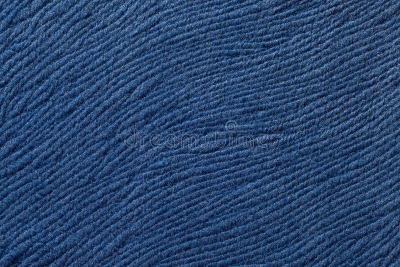 Donkerblauwe achtergrond van zacht textielproduct Stof met natuurlijke textuur royalty-vrije stock fotografie