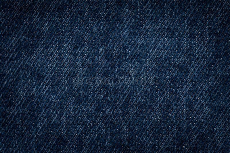 Donkerblauwe denimclose-up als achtergrond Geweven stof stock afbeeldingen