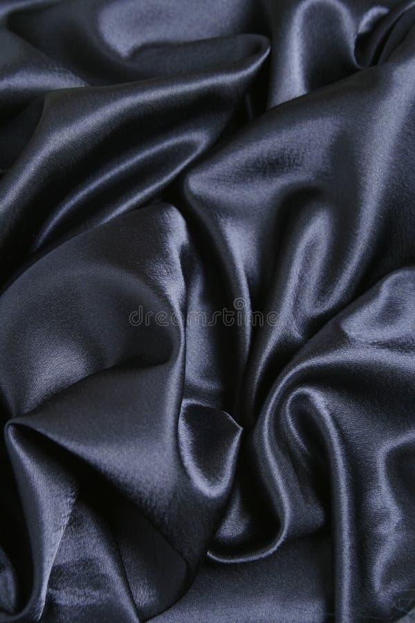 Donkerblauwe satijnachtergrond   royalty-vrije stock foto