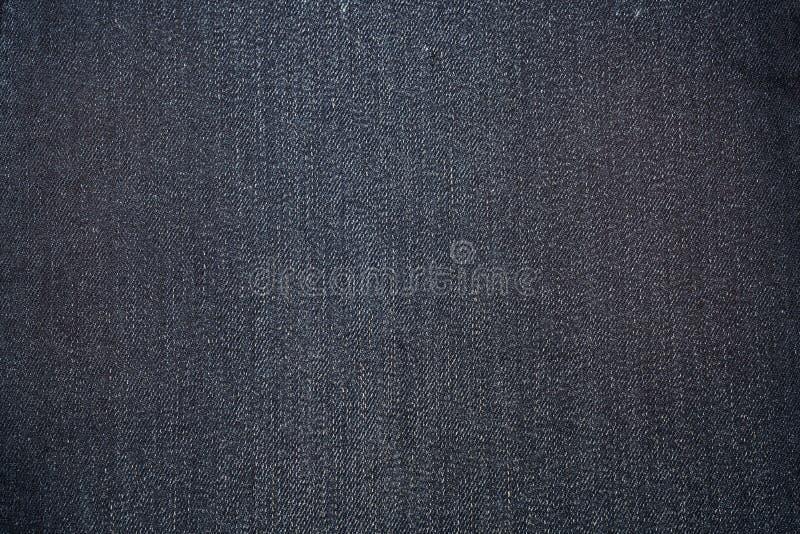 Donkerblauwe textuur van denim of jeansachtergrond royalty-vrije stock fotografie
