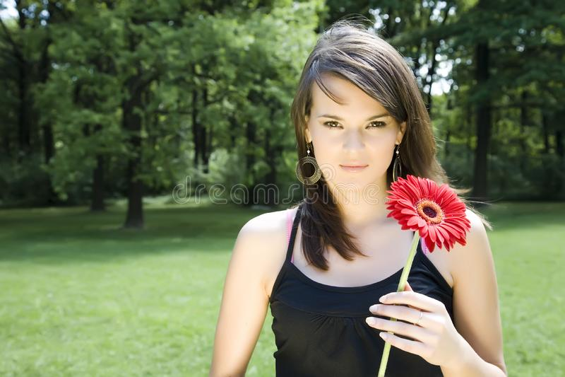 Donkerbruin Modelwith flower royalty-vrije stock foto