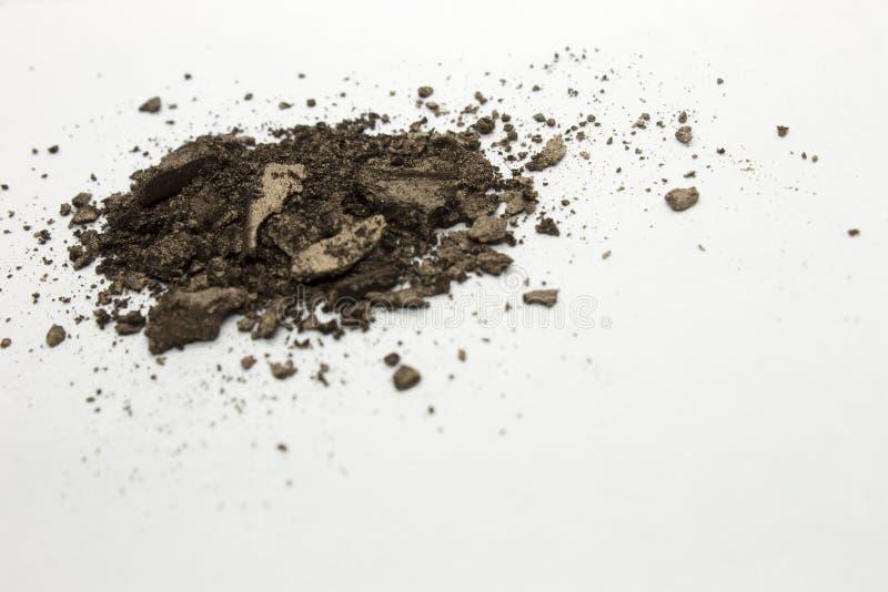 Donkerbruine shimmery poederoogschaduw stock foto