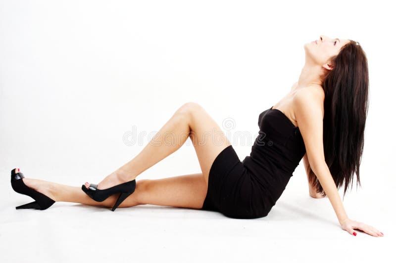 Donkerbruine vrouw stock afbeelding