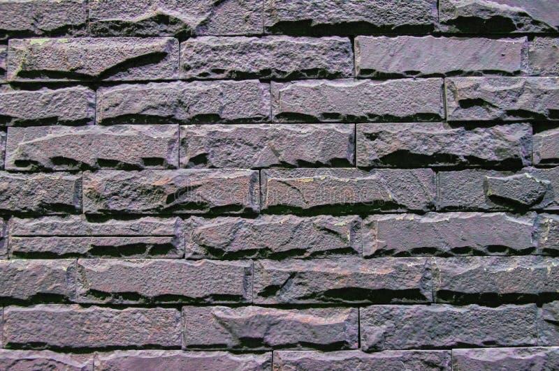 Donkere bakstenen muren grijze textuur voor achtergrond Oude, gekraste, ongelijke oppervlakte stock afbeeldingen