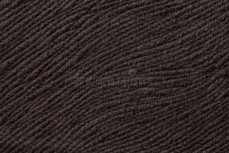 Donkere bruine achtergrond van zacht textielproduct Stof met natuurlijke textuur stock foto