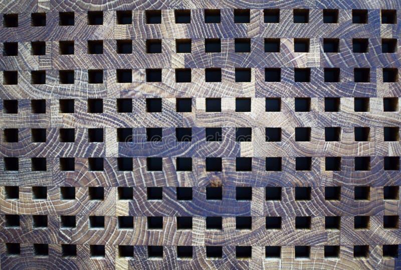Donkere bruine grijze houten textuurraad met zwarte vierkanten royalty-vrije stock foto's