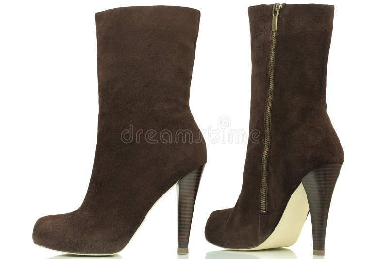 Donkere bruine high-heeled laarzen stock foto's
