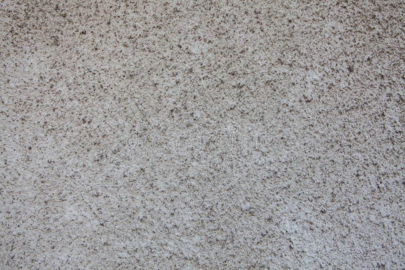 Donkere concrete oppervlakte met abstracte vlekken, naadloze textuur stock afbeeldingen