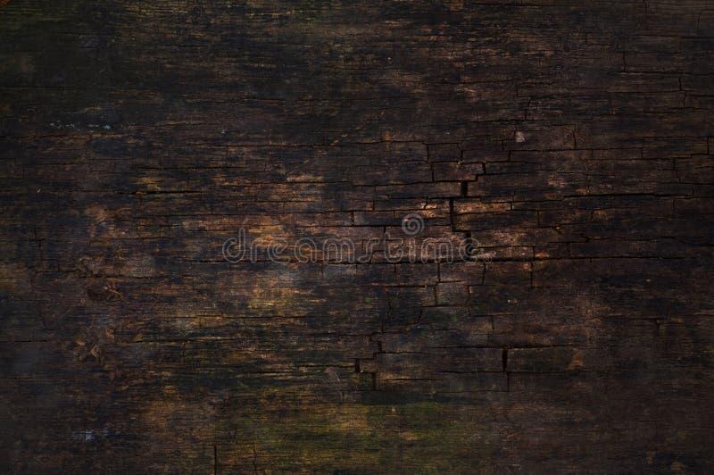 Donkere gebarsten houten oppervlakte royalty-vrije stock afbeeldingen