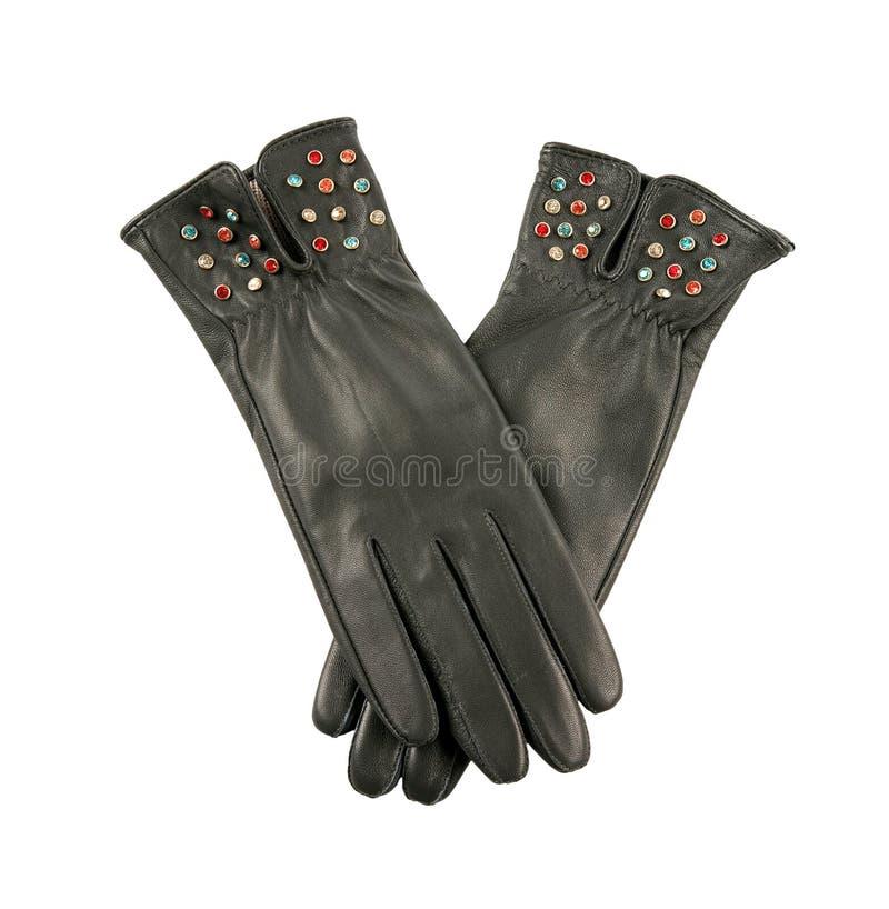 Donkere grijze leerhandschoenen met kleurrijke kristallen stock afbeeldingen