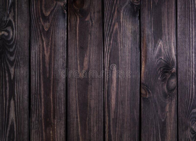 Donkere houten textuur Donkere oude houten panelen als achtergrond Sluit omhoog van muur stock foto's