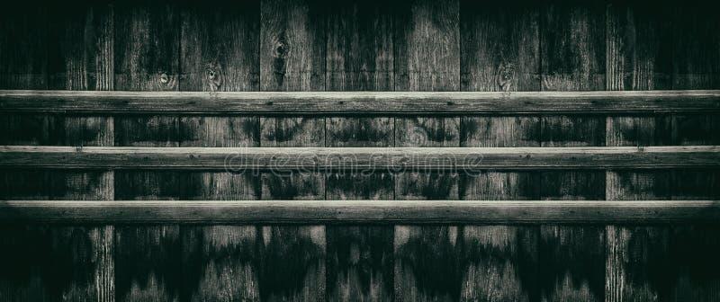 Donkere retro achtergrond - het oude houten brede panorama van de raadsomheining stock foto