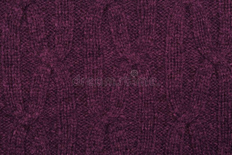 Donkere roze gebreide textuur royalty-vrije stock fotografie