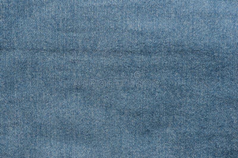 Donkere van het bledenim textieltextuur als achtergrond stock afbeeldingen