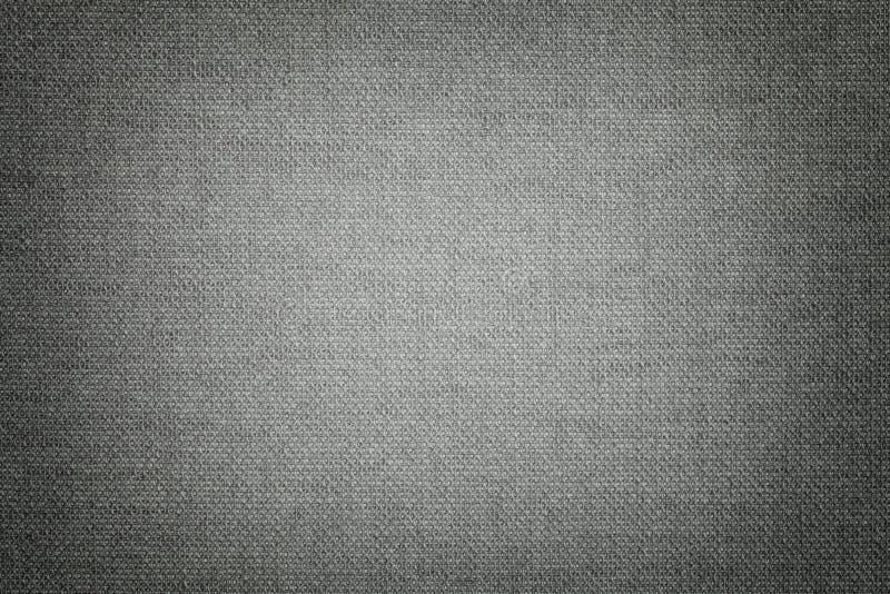 Donkergrijze achtergrond van een textielproduct met rieten patroon, close-up royalty-vrije stock afbeelding