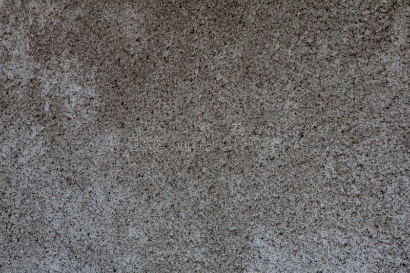 Donkergrijze concrete oppervlakte met abstracte vlekken, naadloze textuur stock foto's