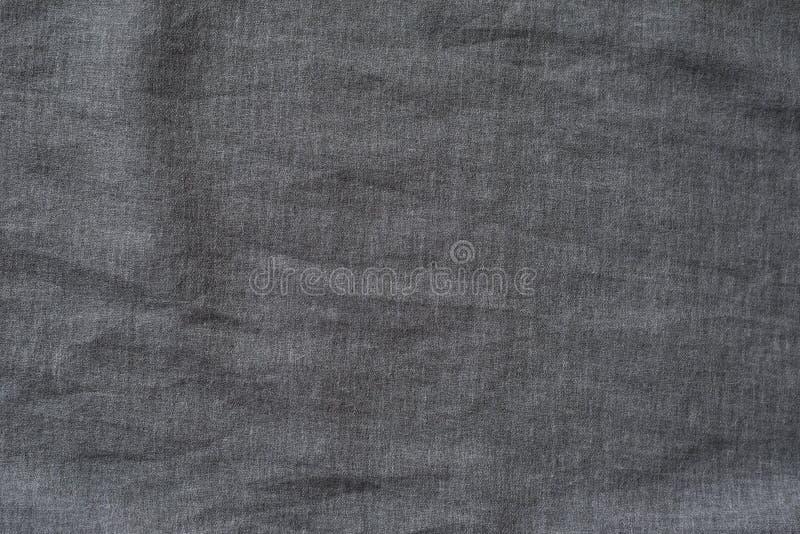 Donkergrijze geweven stof Close-up Achtergrond stock foto's