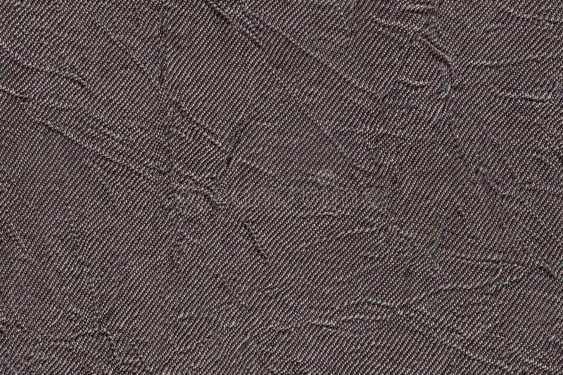 Donkergrijze golvende achtergrond van een textielproduct Stof met de close-up van de vouwentextuur stock foto's