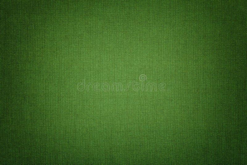 Donkergroene achtergrond van een textielproduct met rieten patroon, close-up stock fotografie