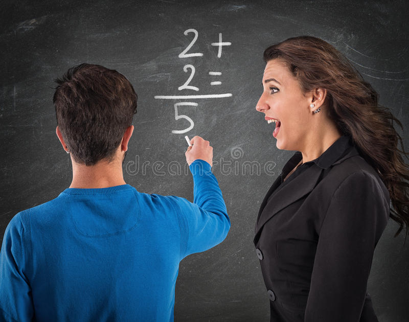 Donkey student and desperate teacher. Student writes math operation and teachers screams royalty free stock photography