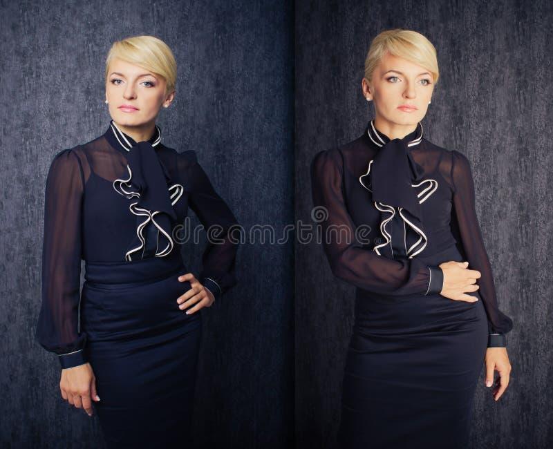 Donna abbastanza bionda di affari in vestito nero fotografia stock
