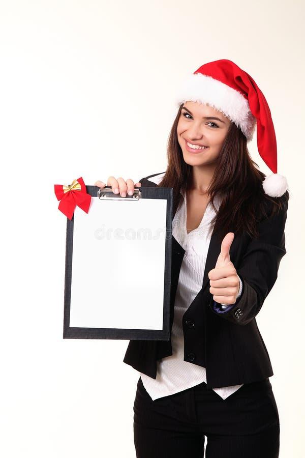 Donna abbastanza giovane in protezione Santa fotografie stock
