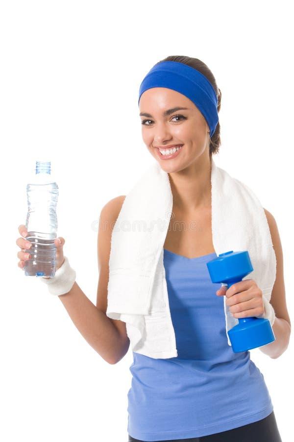 Donna in abiti sportivi con la bottiglia fotografia stock