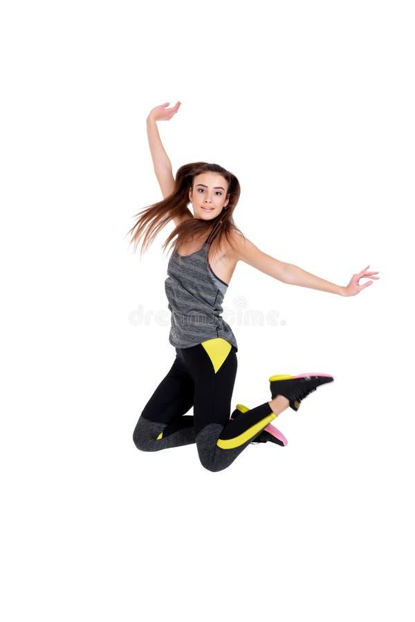 Donna adatta nel salto degli abiti sportivi immagini stock libere da diritti