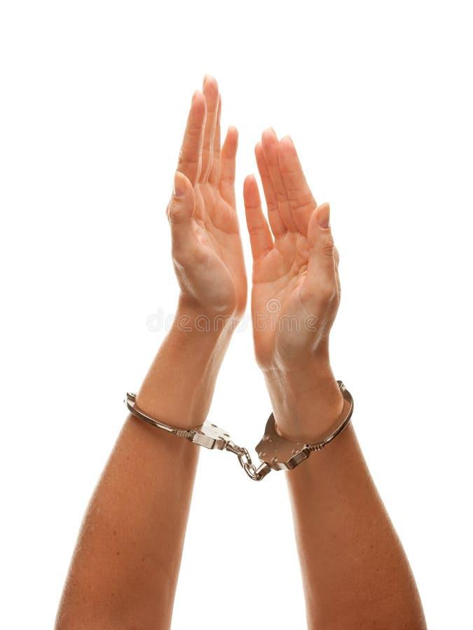 Donna ammanettata che solleva le mani in aria su bianco fotografia stock libera da diritti