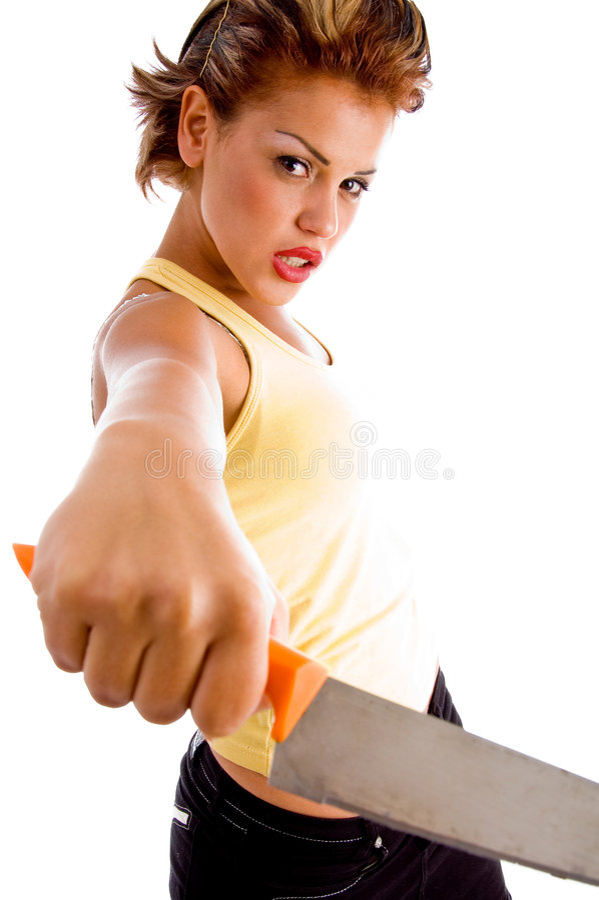 Donna arrabbiata che mostra lama immagine stock libera da diritti
