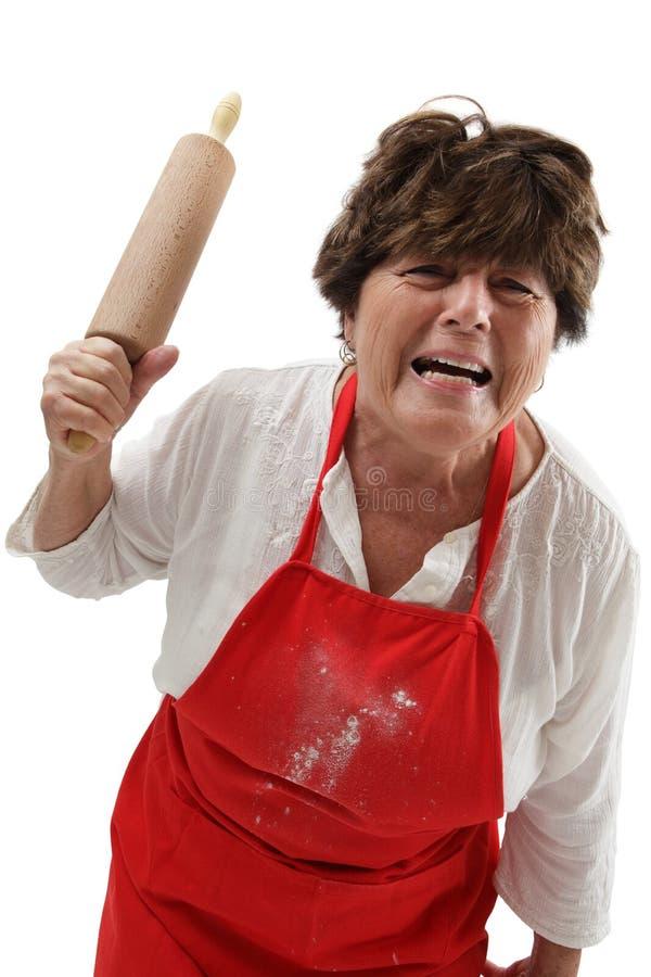 Donna arrabbiata con il perno di rotolamento immagine stock