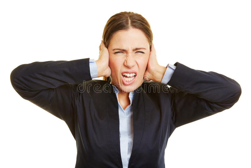 Donna arrabbiata di affari che fa smorfie immagini stock