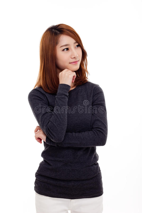 Donna asiatica giovane di pensiero immagini stock