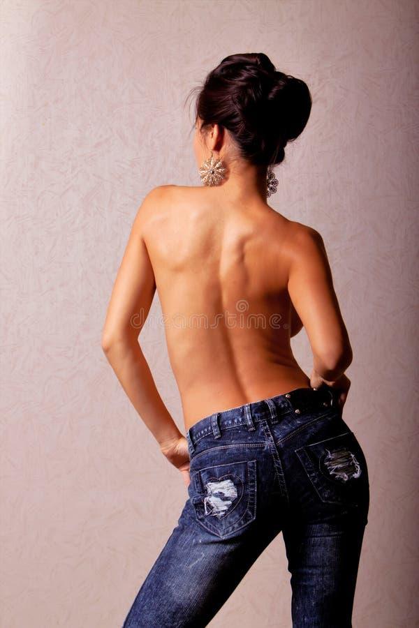 Donna asiatica Topless in blue jeans immagini stock