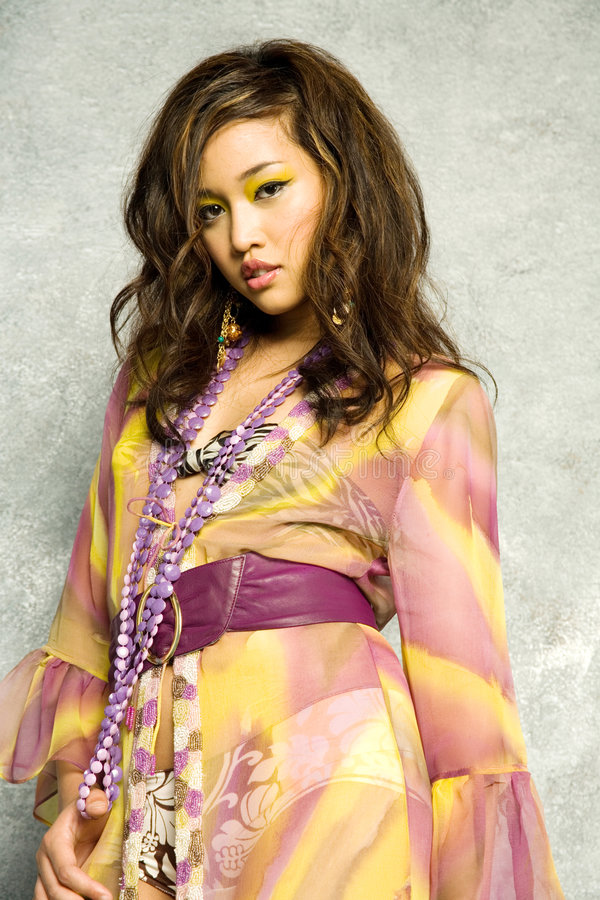 Donna asiatica in vestito immagini stock libere da diritti