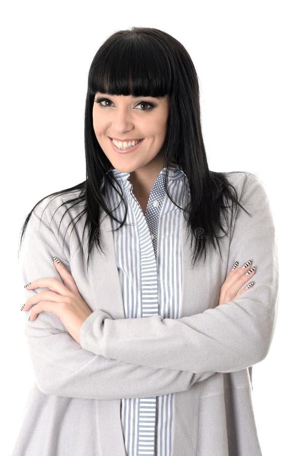 Donna attraente allegra felice con sorridere attraversato armi immagini stock libere da diritti