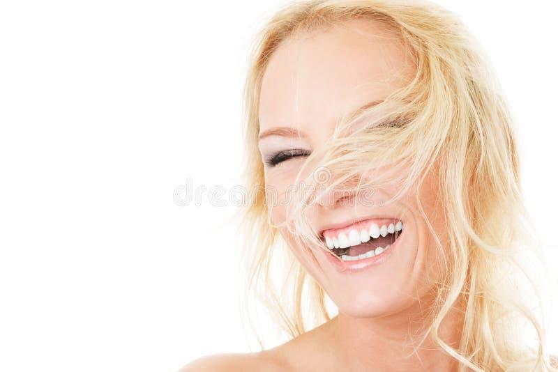 Donna attraente con capelli fly-away fotografia stock libera da diritti