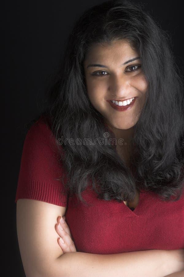 Donna attraente con capelli neri e gli occhi marroni fotografie stock