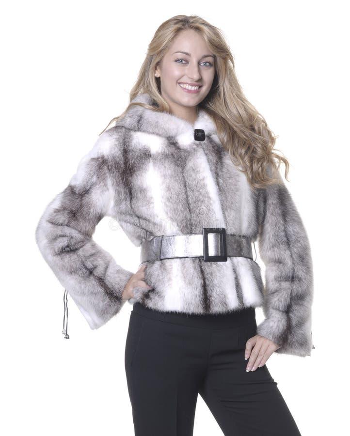 Donna attraente con pelliccia bianca fotografie stock