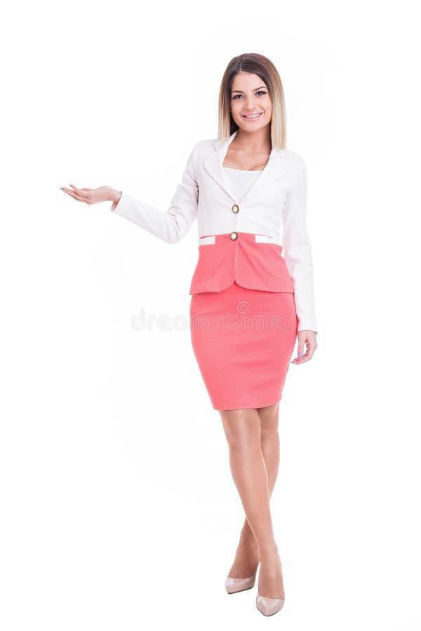 Donna attraente di affari che mostra lo spazio della copia fotografia stock