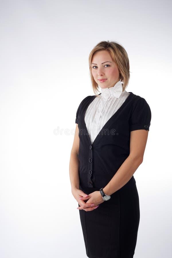 Donna attraente su priorità bassa grigia immagini stock libere da diritti